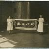 [Rose Meller and Laura Meller holding Chinese flag.]