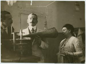 Two men and the Countess Iska Teleki recording a phonograph.