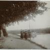 [Boat operator? (Two women near a boat on a canal.).]