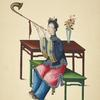 Woman seated on green bench, playing wind instrument with a curved bell.]