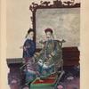 Man sitting on ornately carved chair in front of screen ; young attendant next to chair.]