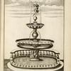 [Fountain with two central basins and sculpture of nude youth holding dolphin.]