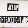Dead women can't vote. Cure AIDS.  Verso: ACT UP. Fight Back. Fight AIDS.