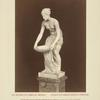 [Nude woman carrying basin.]
