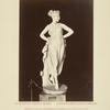[Statue of woman wearing crown of flowers and gown.]