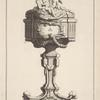 [Ciborium with two cherubs holding crucifix and book on lid.]