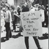 "Donna Gottschalk holds poster ""I am your worst fear I am your best fantasy"" at Christopher Street Gay Liberation Day parade, 1970."