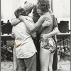 Women embracing at Michigan Womyn's Music Festival, 1976.
