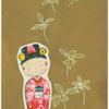 Kokeshi doll and plant design on gold background.]