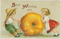 Vintage Thanksgiving postcard: Two children and a pumpkin
