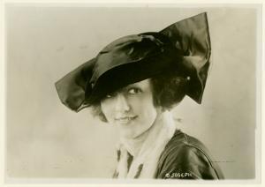 [Woman wearing a black hat.]