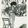 Guitar player at GAA fashion show, 1971 Jun 20