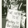 "Mother with sign reading ""We Are Proud To Be Marching For Our Children"""