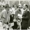 Frank Kameny and fellow spokesperson talk with spectators