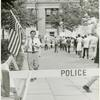Leo Skir with American flag in picket line
