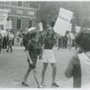 Women picketing while holding hands, original