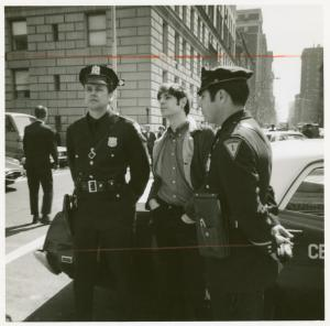 [Marty Robinson with police officers] / Kay Tobin Lahusen