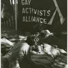 Men kissing under the Gay Activists Alliance banner