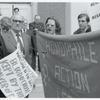 HAL members confront McIntire, with banner