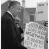 McIntire holding sign