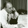 Frank Kameny with calendar, on phone