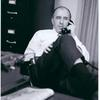 Frank Kameny on phone in his office