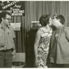 "Barbara Gittings and Isabel Miller kissing at the ""Hug a Homosexual"" booth, ALA"