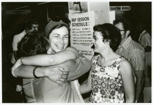[Isabel Miller hugging a librarian as Barbara Gittings looks on] / Kay Tobin Lahusen