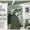 "Psychiatrists looking at ""Gay Proud and Healthy"" display #1"