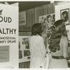 """Psychiatrists looking at """"Gay, Proud and Healthy"""" display #3"""