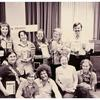 Group portrait of Phyllis Lyon, Del Martin, and members of the ALA Task Force on Gay Liberation holding gay books