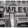 Jim Owles in front of campaign banner