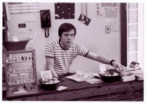[Craig Rodwell behind the counter of the Oscar Wilde Memorial Bookshop] / Kay Tobin Lahusen