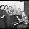 Betty Comden, Rosalind Russell, Adolph Green, George Abbott, Lehman Engel, and Leonard Bernstein (at piano) in rehearsal for the stage production Wonderful Town, 1953.