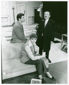 Production still, including Fred Willard (left), Carole Shelley, and Shimen Ruskin (right)