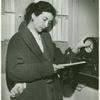 Publicity series: Betty Miller clocking in a few minutes before her shift at the stocking counter.