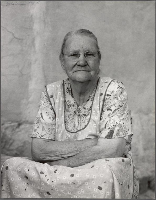 "12. Mormon mother who says she's ""been looking up at that old black ridge"" since 1877...Gunlock, Utah. 1953."