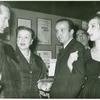 Ted Mann with Lucielle Lortell (left) and wife Patricia Brooks at either an opening night party for unidentified early production or 10th anniversary party