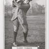 Harry Vardon. Top of swing - full iron shot.