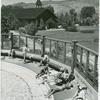 Sunbathers poolside]