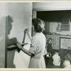 Woman writing on chalkboard]