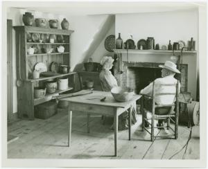 [Woman and man sit in Walt Whitman farmhouse kitchen]