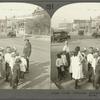 Traffic Policeman Helping Children to Cross the Street.
