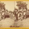 [Man and children with ox-pulled wagon.]