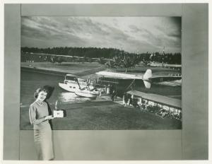 Woman in front of Afga Ansco exhibit photograph