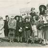 Women standing in front of United Airlines airplane