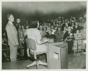 American Telephone & Telegraph Exhibit - Man and woman in front of crowd