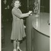 American Telephone & Telegraph Exhibit - Girl at display
