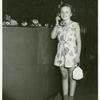 American Telephone & Telegraph Exhibit - Girl standing holding phone