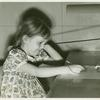 American Telephone & Telegraph Exhibit - Girl taking hearing test